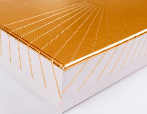 Rigid box corner with embossing and gold lamination