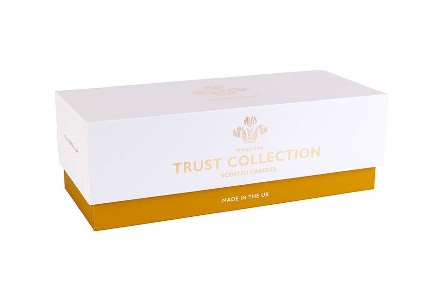 Shoe-style printed rigid Candle box with gold base, white lid and a foiled logo on the front.